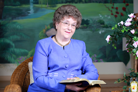 Margaret Drake reading a book